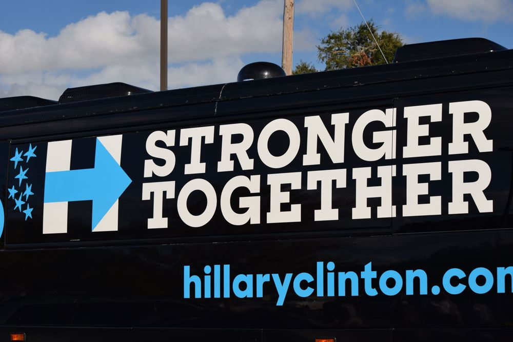 Former President Bill Clinton arrives in a Hillary Clinton tour bus!